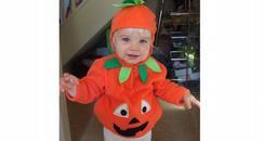 Evie in a Pumpkin costume