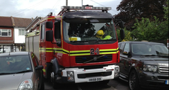 Fire engine struggles through parked cars