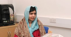 Malala Yousafzai with flowers at the QE Hospital