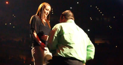 man proposing on stage