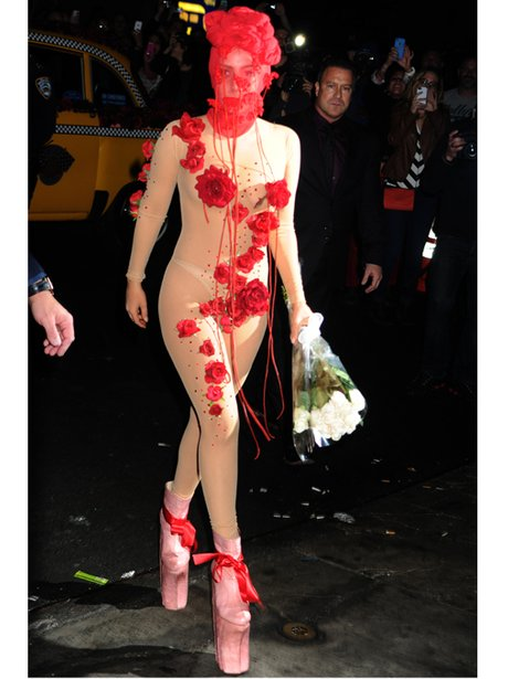Lady Gaga in a nude moph suit and mask