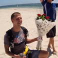 A man proposes on a beach