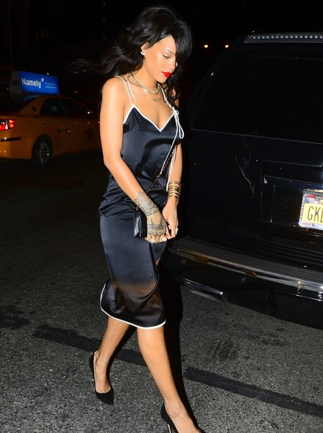 Rihanna wearing a black dress