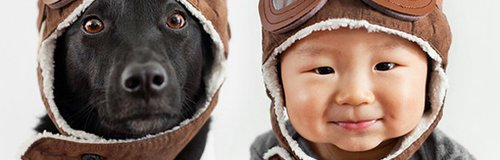 baby and dog in helmets