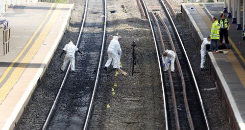 Police search the tracks at Slough