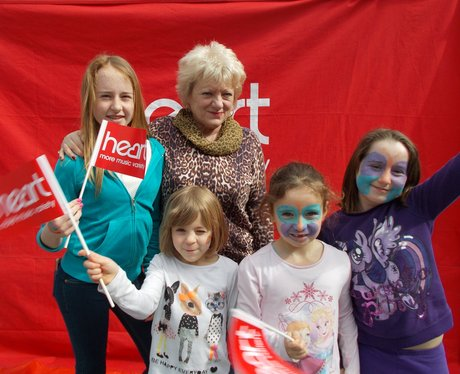 a group of girls outside heart tent
