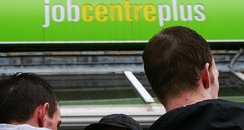 A pair of jobseekers look for work at a job centre