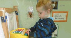 Liam Fee playing at nursery