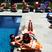 Image 2: Sofia Vergara lying by a swimming pool
